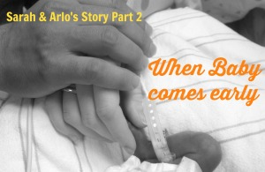 Sarah & Edward hold preemie Arlo's foot